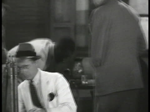 journalists from all over the world gather at imperial hotel greeting each other reading writing on typewriter male reading news from washington:... - 1935 stock videos & royalty-free footage