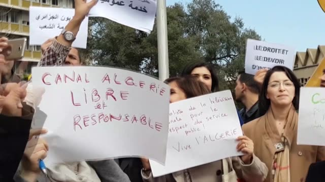 journalists from the algerian public television rally to denounce the media coverage of the protests against a fifth term of president abdelaziz... - アルジェリア点の映像素材/bロール