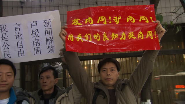 journalists in china are taking part in rare protests over censorship it comes after a weekly newspaper's new year message was changed by state... - censura video stock e b–roll