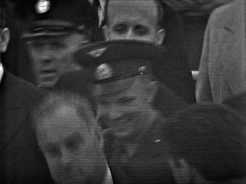 Journalists surround Yuri Gagarin as he arrives at London airport for a tour of the UK