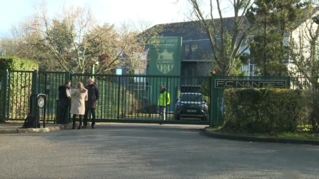 journalists wait outside the entrance of fc nantes following the disappearance of a plane carrying one of the club's former players - nantes stock videos & royalty-free footage