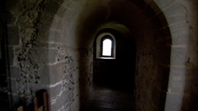 A journey along the arched passageways of Hedingham Castle. Available in HD.