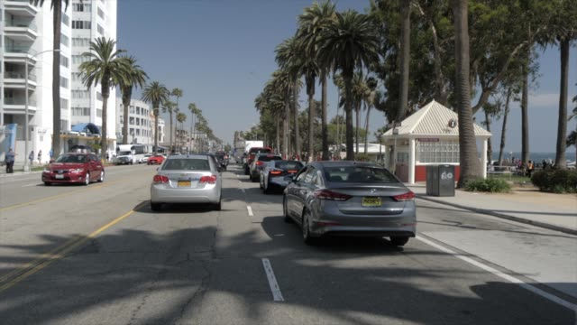 journey by car along ocean avenue, santa monica, los angeles, california, united states of america, north america - santa monica street stock videos & royalty-free footage