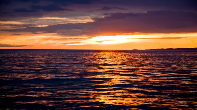 HD: Journey on sea at sunset