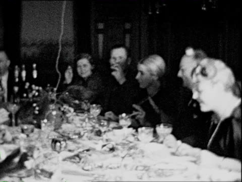 1932 b/w montage jovial crowd of well-to-do germans drinking and laughing at dinner table / braunschweig, lower saxony, germany - 1932 stock videos & royalty-free footage