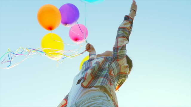 joy moments in slow motion. - balloon stock videos and b-roll footage