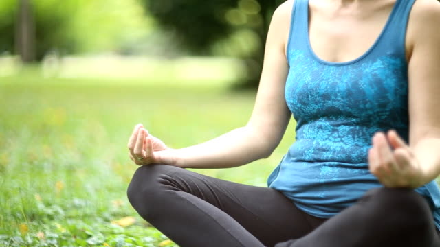 joy of doing yoga - lotus position stock videos & royalty-free footage