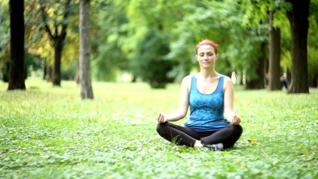 joy of doing yoga - lotus position stock videos & royalty-free footage