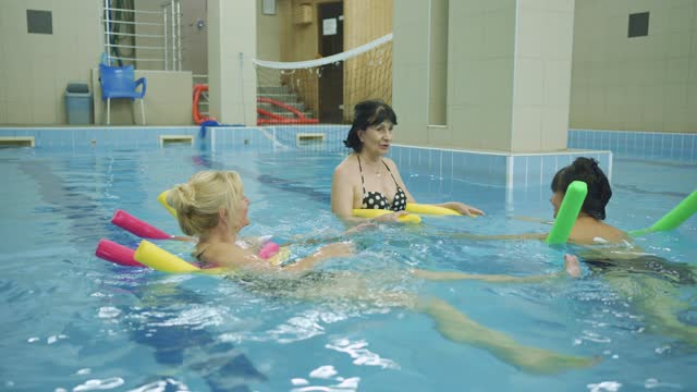 joyful active senior women sharing impression of their aqua aerobic class and seems they have positive experience - aerobics stock videos & royalty-free footage
