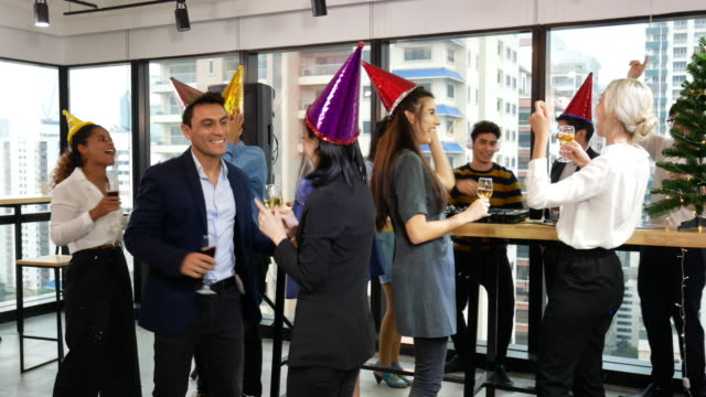 joyful business team happy new year party and christmas celebration in the offices. - 2020 business stock videos and b-roll footage