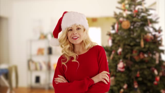 joyful caucasian woman dancing in front of christmas tree at home in the morning - santa hat stock videos & royalty-free footage