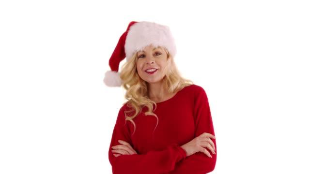 joyful caucasian woman in santa hat dancing on white background with copyspace - santa hat stock videos & royalty-free footage
