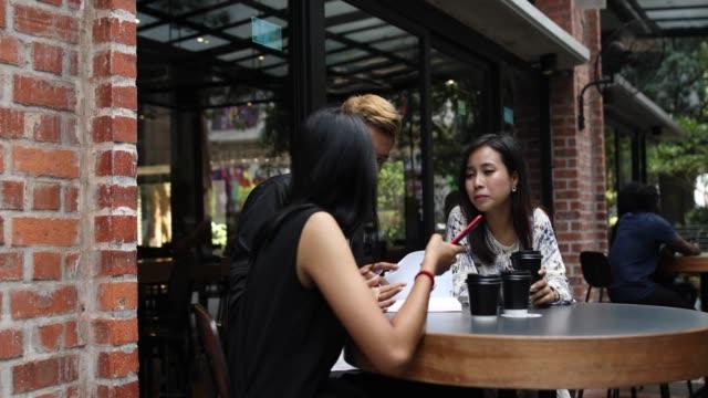 joyful coffee break - malayan ethnicity stock videos and b-roll footage