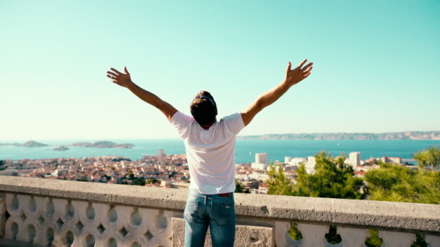 joyful couple punching the air over marseille cityscape - notre dame de la garde marseille stock videos and b-roll footage