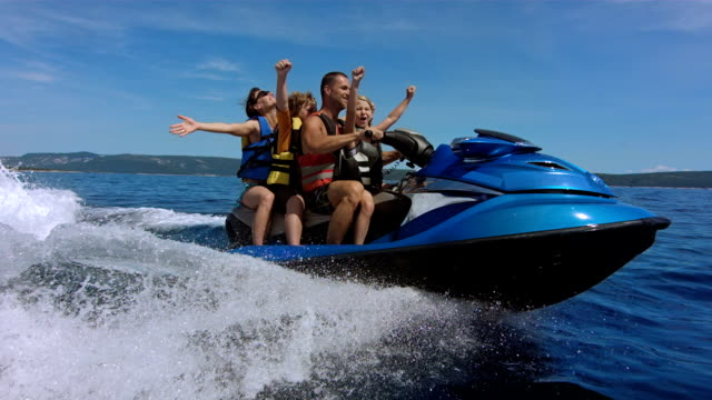 slo mo joyful family riding a jet boat - getting away from it all stock videos & royalty-free footage