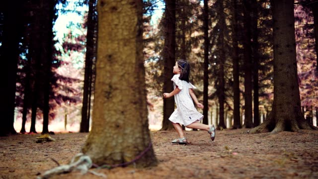 joyful girl hopping through the forest - dress stock videos & royalty-free footage