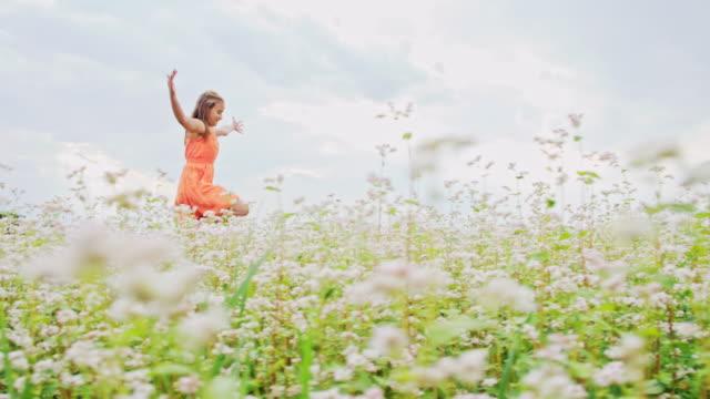 SLO MO Joyful girl in the buckwheat field