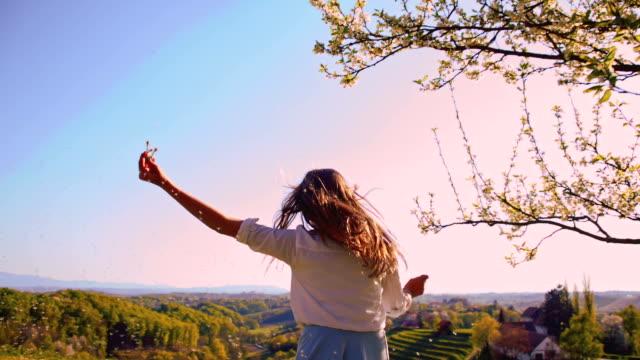 SLO MO Joyful girl running with dandelions
