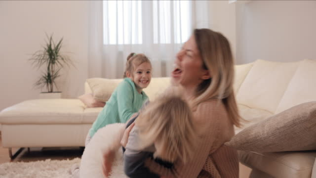 joyful kids and their mother playing at home and having fun together. - pillow fight stock videos & royalty-free footage