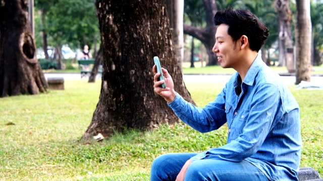 joyful male video messaging - long distance relationship stock videos & royalty-free footage