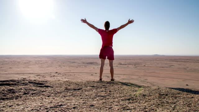 wa joyful man in the desert - namibian desert stock videos and b-roll footage