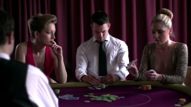 stockvideo's en b-roll-footage met joyful man winning against two girls - overhemd en stropdas