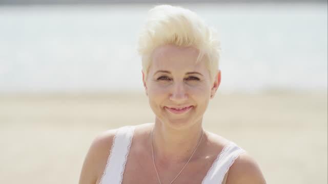joyful mature woman smiling - headshot stock videos & royalty-free footage