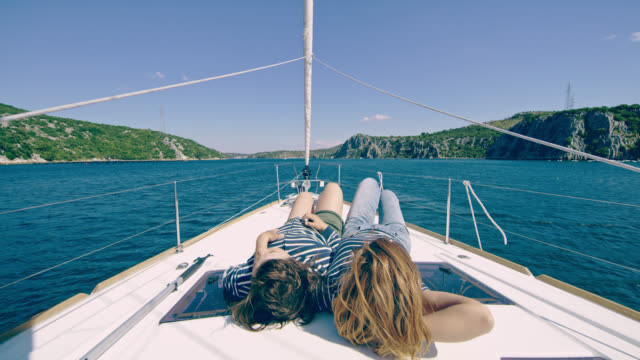 ds joyful mother and daughter sailing on a sailboat - croatia stock videos & royalty-free footage