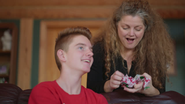 joyful mother opens up christmas present from loving son - bar of soap stock videos & royalty-free footage