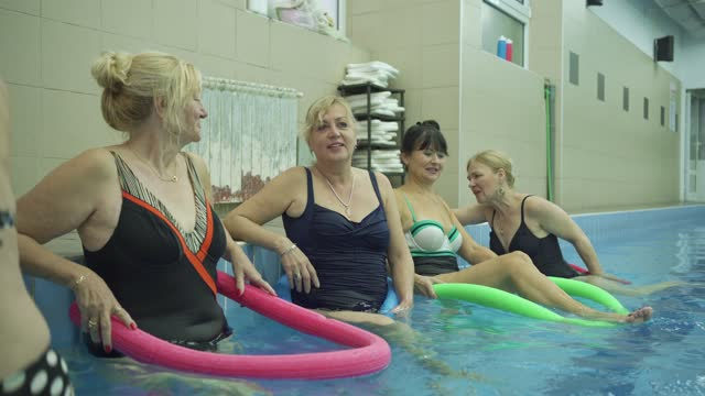 joyful senior women enjoying their water aerobic class, so their body can be fit even at this old years - 65 69 years stock videos & royalty-free footage
