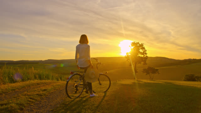 slo mo joyful woman punching the air while enjoying a sunset - anticipation stock videos & royalty-free footage