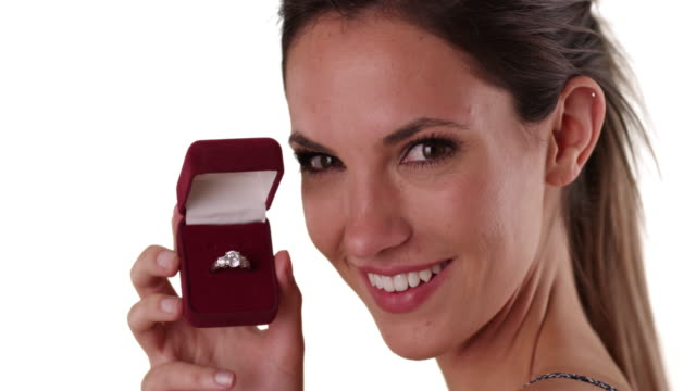 joyful woman showing diamond ring in jewelry box to camera on white copy space - jewelry box stock videos and b-roll footage