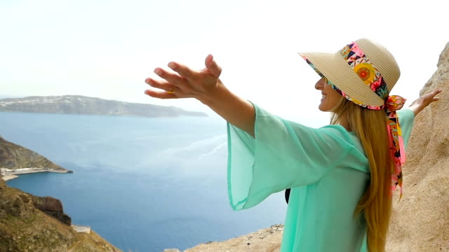 joyful woman & vacations in santorini - greece stock videos & royalty-free footage