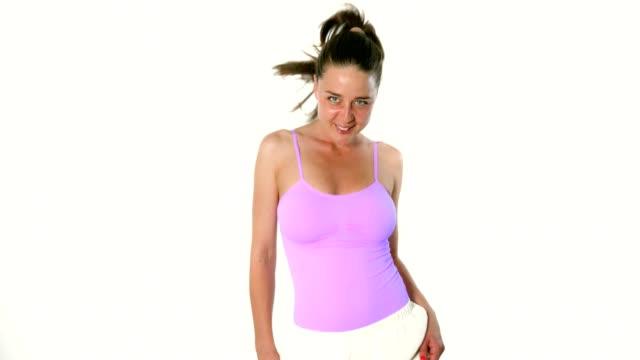 Joyful young woman fashion model catwalk posing in studio