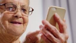 Joyous Senior Woman Using Smartphone