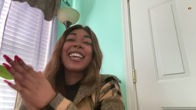 joyous woman gets excited as she claps and cheers on a video call - young women stock videos & royalty-free footage