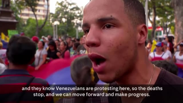 juan guaido vows to unblock humanitarian aid to venezuela from us; colombia, cucuta; venezuela protesters marching and chanting with venezuelan flags... - protestor stock videos & royalty-free footage
