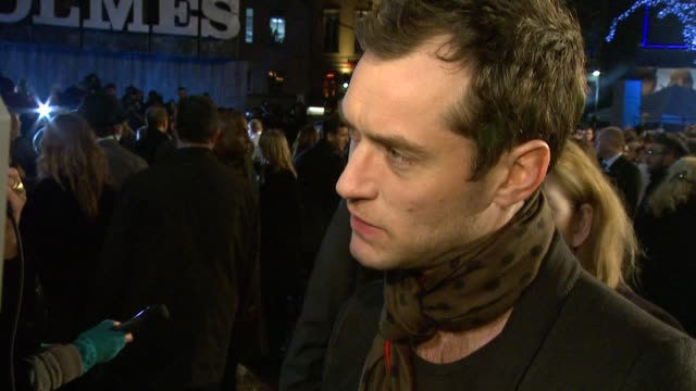 jude law on learning from robert downey jr on acting on being proud of the film at the sherlock holmes uk premiere at london england - sherlock holmes stock videos & royalty-free footage