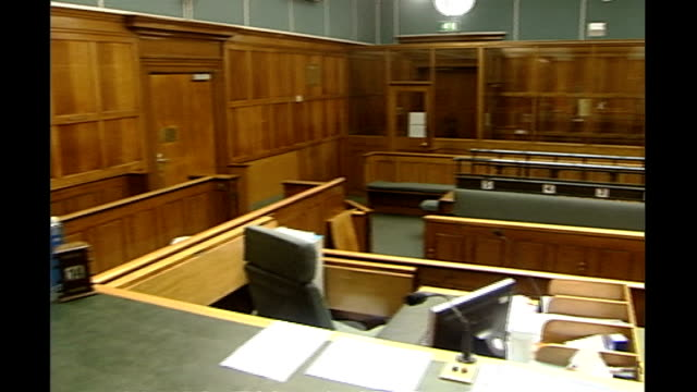 judge and prosecutor in sexual abuse case to be investigated int interiors of empty courtroom including shots of 'holy bible' and jury bench in court - staatsanwalt stock-videos und b-roll-filmmaterial