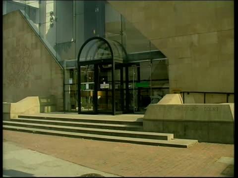 nottingham crown court entrance to court ms crest on wall angle gv entrance - ノッティンガム点の映像素材/bロール