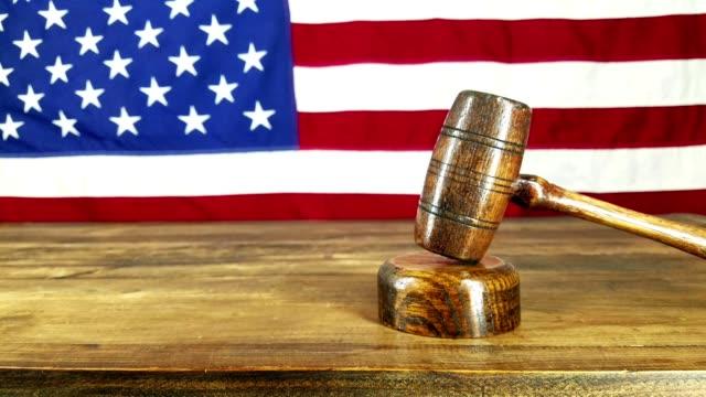 judge banging gavel.  american flag backdrop. - fringe stock videos & royalty-free footage