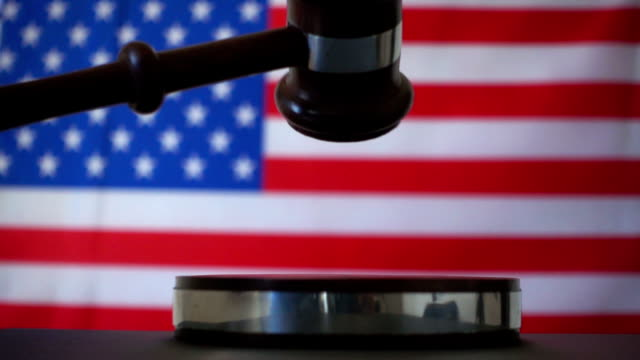 judge calling order with gavel in american court - governo video stock e b–roll