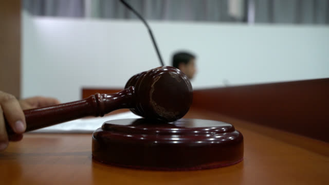 Judge closing the hearing banging the gavel