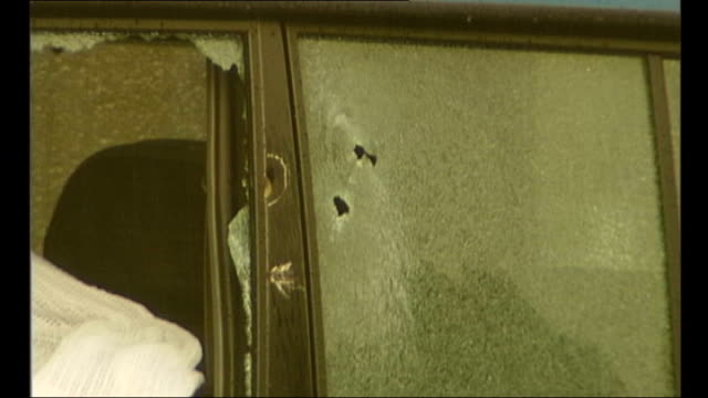 Judge criticises evidence of witnesses in supergrass trial 2000 Bullet hole in car window PULL OUT