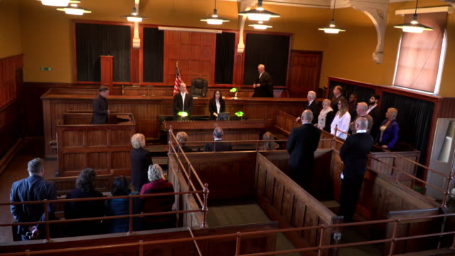 4k: judge enters the courtroom for court case - judges stock videos and b-roll footage