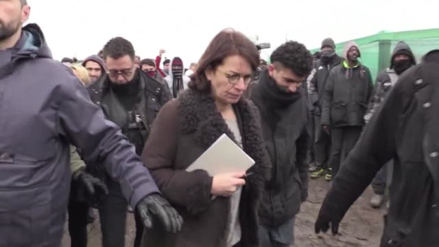 a judge from lille's administrative court visits the calais 'jungle' camp on tuesday ahead of her verdict later in the day on whether or not to... - lille stock videos & royalty-free footage