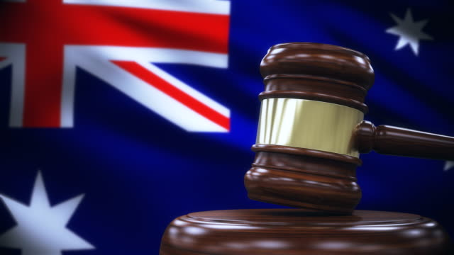 judge gavel with australia flag background - law stock videos & royalty-free footage