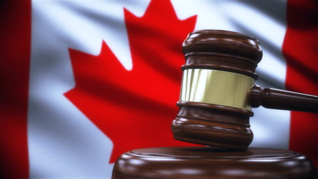judge gavel with canada flag background - gavel stock videos & royalty-free footage