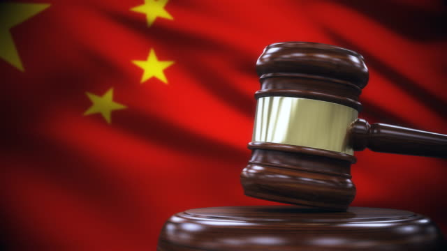 judge gavel with china flag background - court room stock videos & royalty-free footage