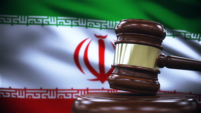 judge gavel with iran flag background - law stock videos & royalty-free footage